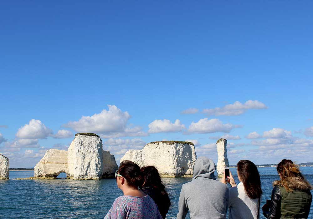 Passengers looking at Old Harry Rocks - City Cruises Poole