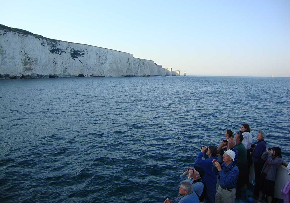 People aboard in front of Old Harry Rocks - City Cruises Poole
