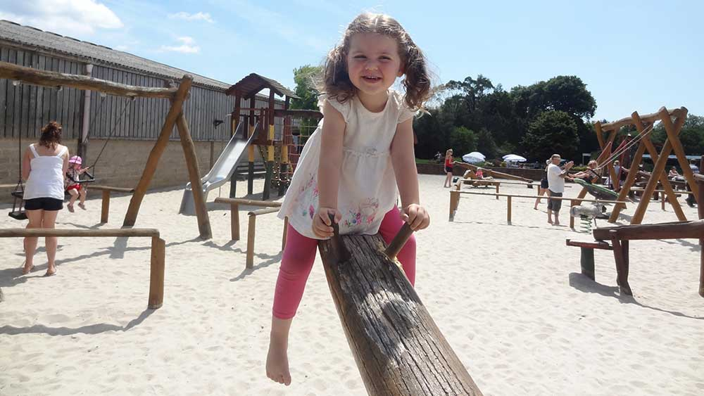 Sand play in the sunshine at Farmer Palmer's Farm Park