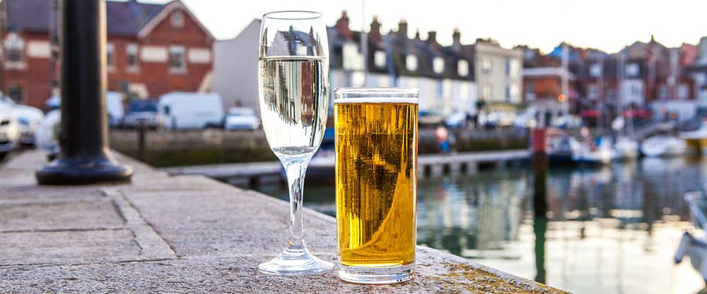 Enjoying a drink beside the harbour in Dorset