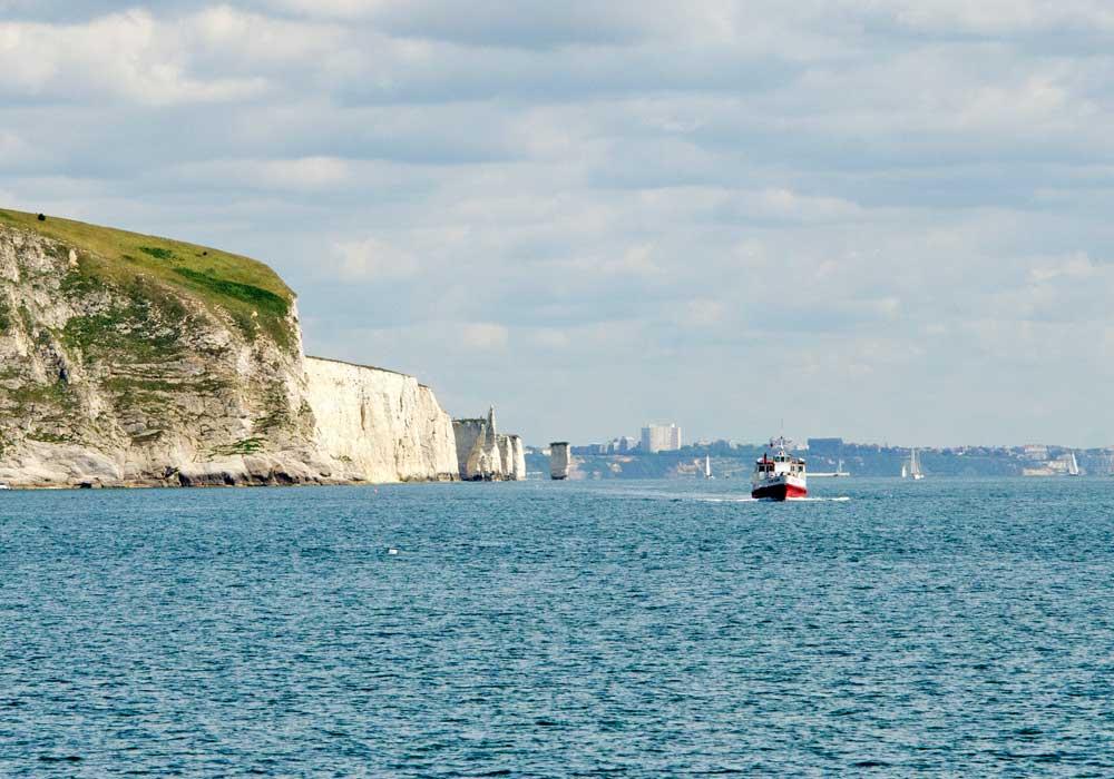 Boat alongside Old Harry Rocks - City Cruises Poole