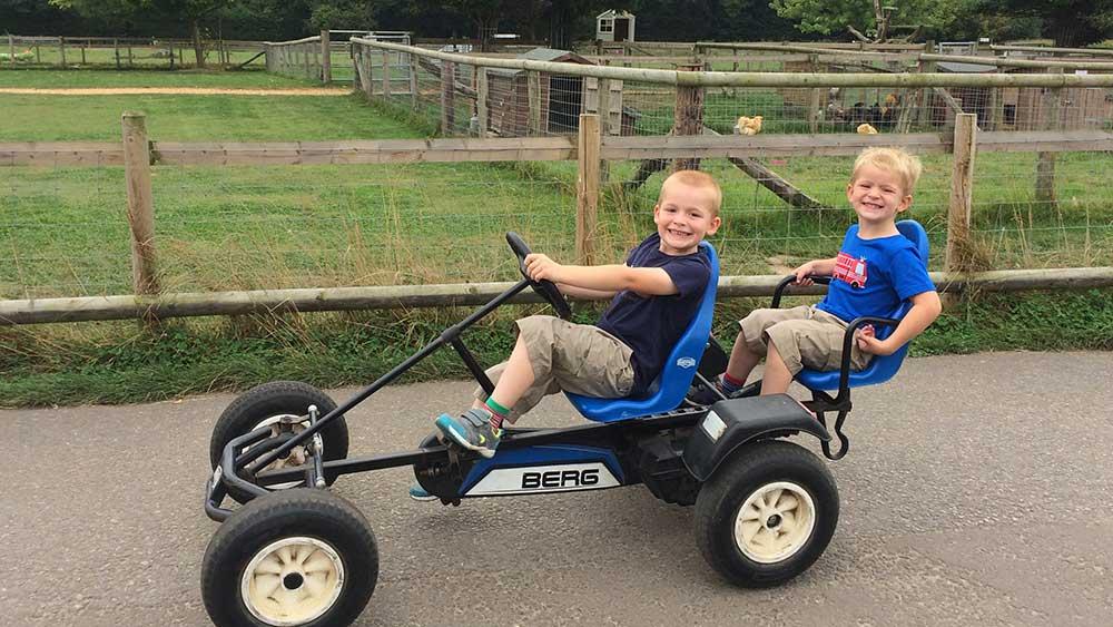 Boys on go karts at Farmer Palmer's Farm Park