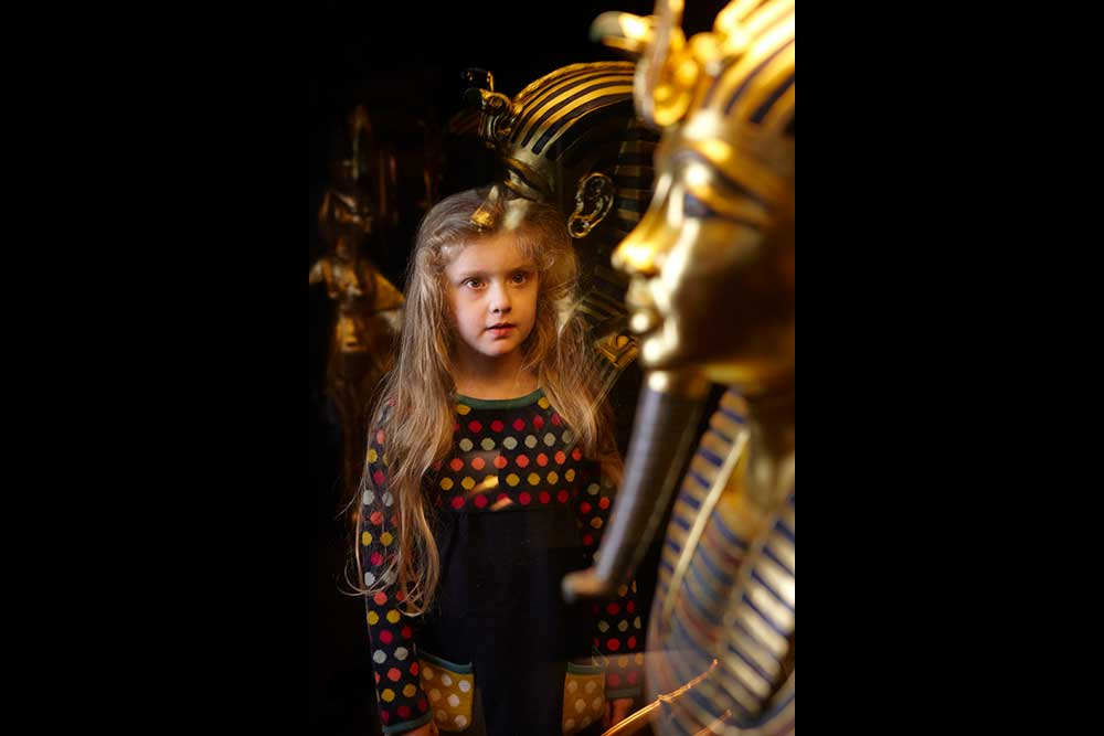Child learning about Ancient Egypt at The Tutankhamun Exhibition